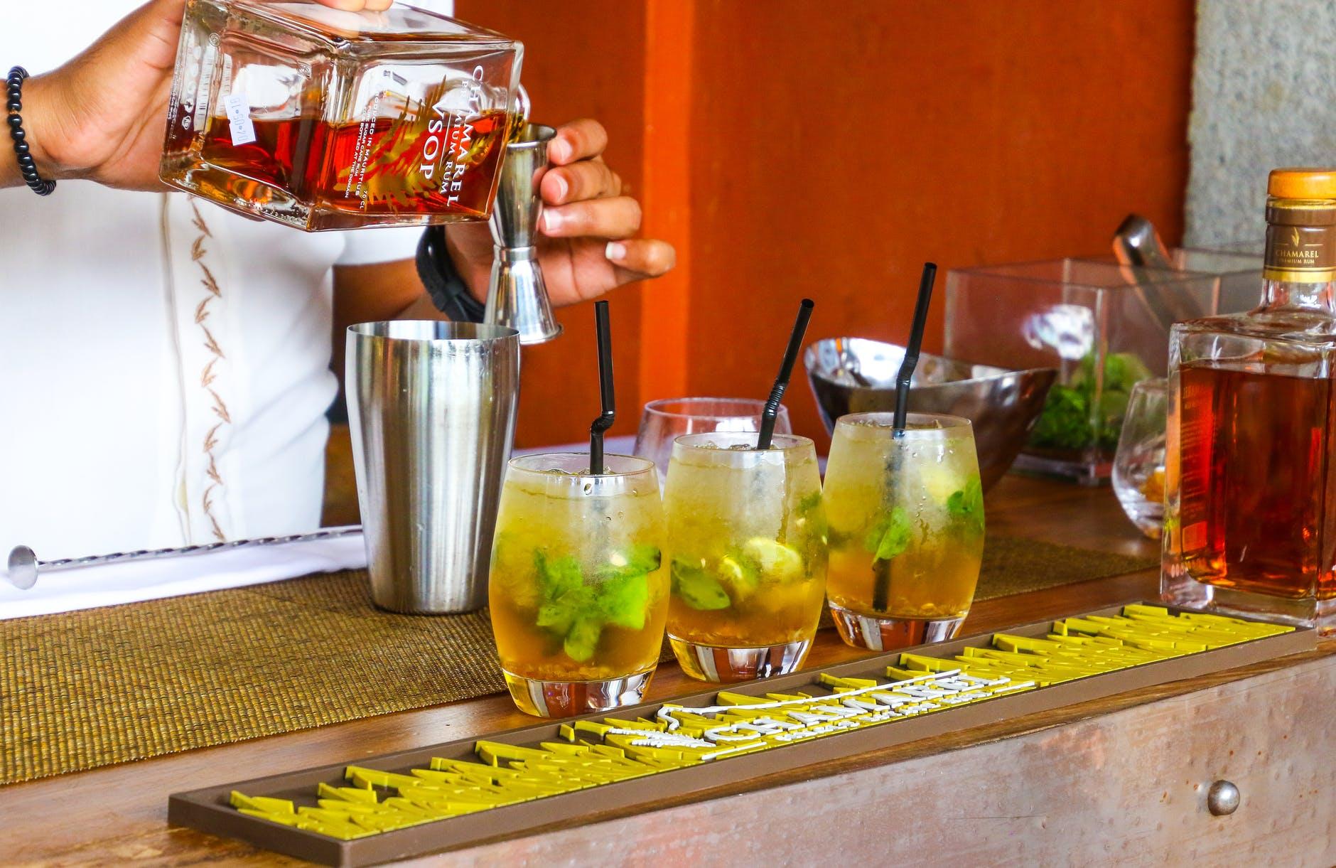person preparing rum drink